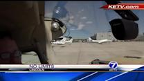 Triple amputee pilot learns to fly again