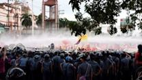 Police Deploy Water Cannon at Anti-Government Protest