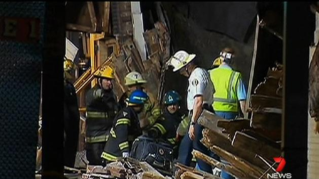Woman pulled alive from building collapse