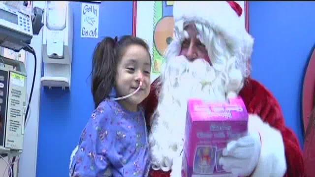 Firefighters, Marines and Santa visited children in the hospital