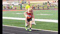 Teen Carries Twin Sister Over Finish Line at Track Meet