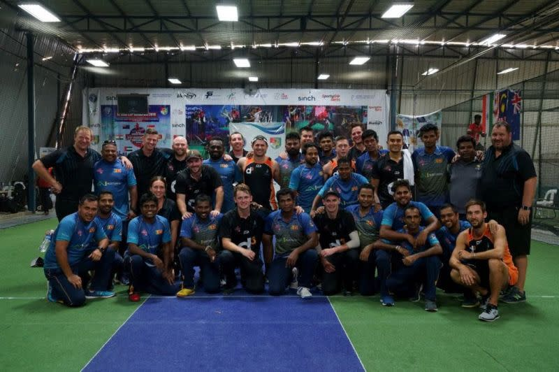 New Zealand and Sri Lanka pose for a group photo after the Grand Final (Image Courtesy: Singapore Cricket Association)