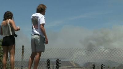 Fires Leave Smoldering Homes, Scorched Earth