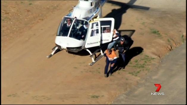 Helicopter flies workers over protest