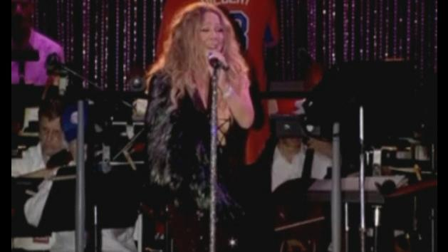 Mariah Carey performs in 'bling slings' at charity show