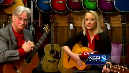 Kim St. Onge tries her hand at guitar