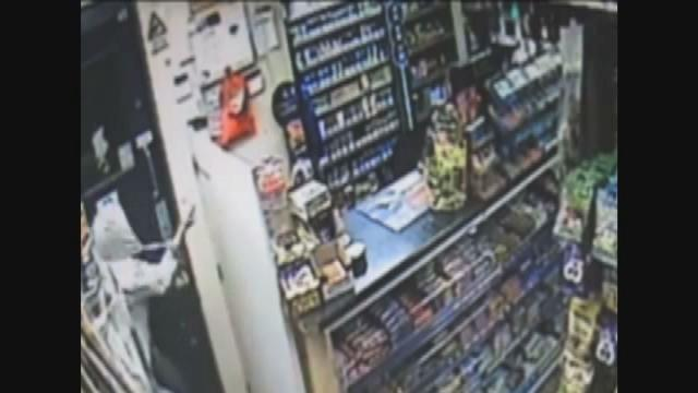 Fearless shop worker disarms knife wielding robber