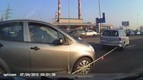 Woman Drives into Tow Rope