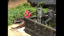 Watch: Family rescued from typhoon floods in China