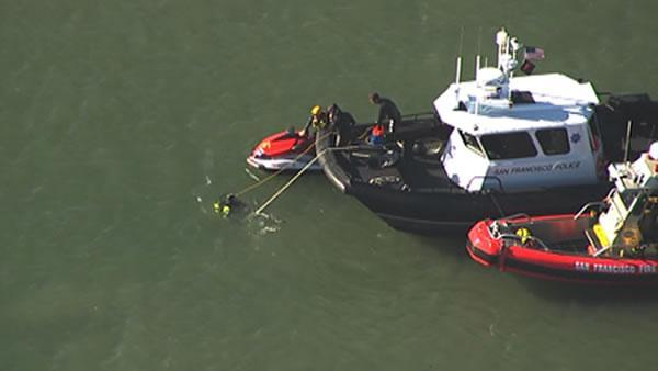 Search underway after car drives into water in SF