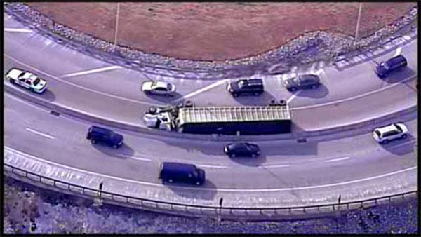 Truck carrying trash overturns in King of Prussia