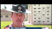 State trooper opens fire on suspect in cemetery