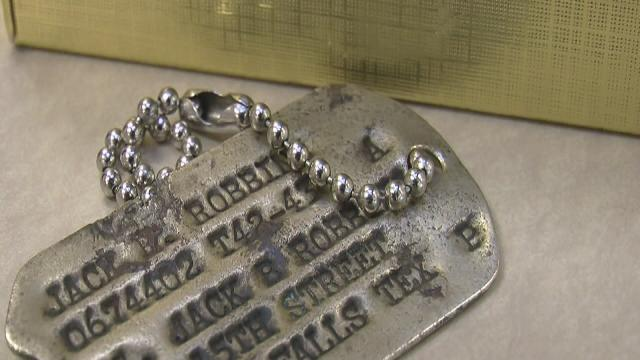 Medina boy returns military dog tags to family of WW II pilot during emotional school ceremony