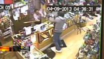 Watch: Shop owner fights off gunman with bat