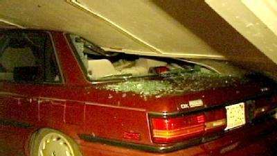 Homes, Cars Damaged By Storm