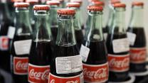 Coca-Cola tops estimates; Viacom, Snapchat extend deal; Sears near 52-week low on sales warning