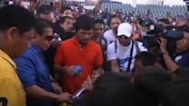Filipino boxing legend Pacquiao visits typhoon victims