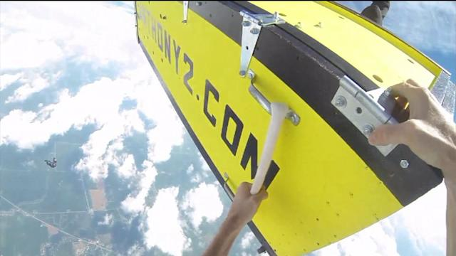Daredevil jumps from plane while in locked coffinRead more: http://wgntv.com/2013/08/06/daredevil-jumps-from-plane-while-in-locked-coffin/#ixzz2bFaIgE31