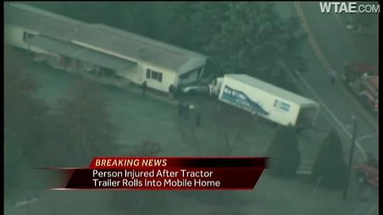 Tractor-trailer hits mobile home