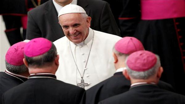 Pope Francis says he will not judge gay priests