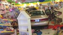 Disaster narrowly avoided when car plows through toy store