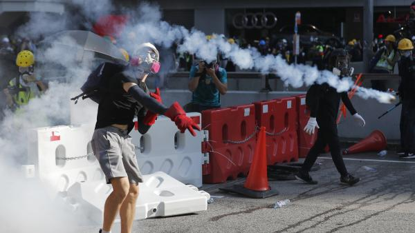 The Latest: Protesters besiege Hong Kong police HQ