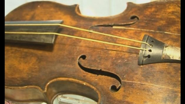 The moment the Titanic violin sells for £900,000