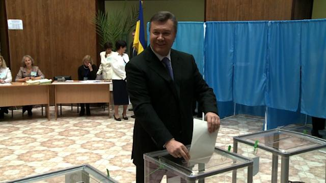 Observers slam Ukraine poll as ruling party nears victory