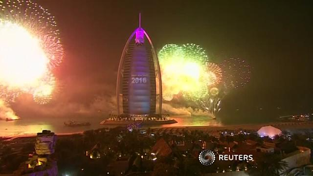 Dubai fireworks kick off as nearby tower burns
