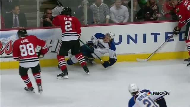 Keith shoulders Oshie with a heavy hit