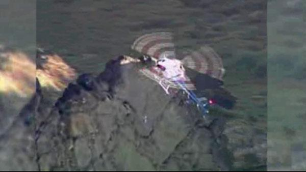 Two teens saved in dramatic cliff rescue