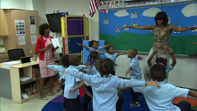 Michelle Obama gets her groove on with school kids