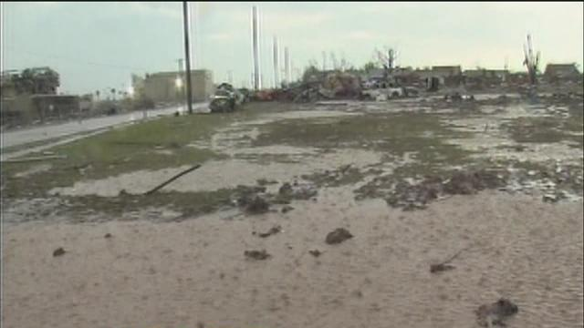 Thunderstorms slow tornado cleanup