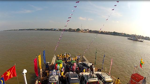 ASEAN rally convoy crossing Mekong river by ferry