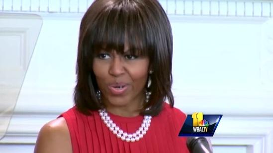 First lady praises midshipmen, attends bill signing