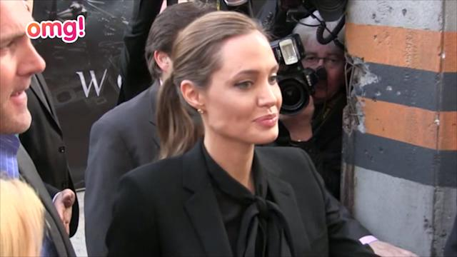 Angelina covers up for Paris premiere