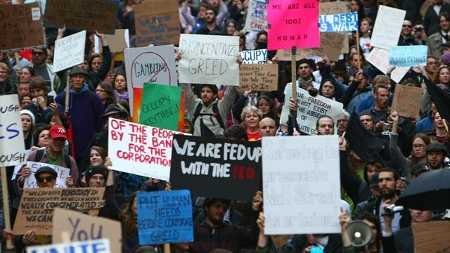 After four weeks, Wall St. protests lack definition