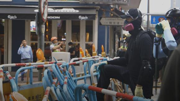 WRAPUP 7-Hong Kong police fire tear gas after fending off