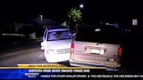Woman arrested after SUV hits parked cars