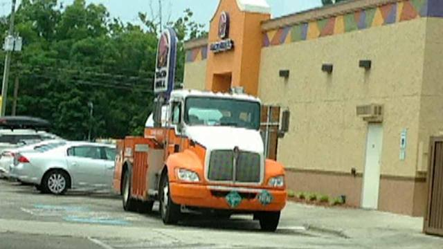 Delivery truck blocks handicapped parking spaces