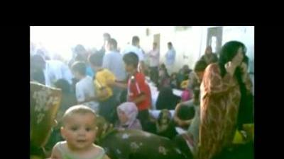 Syrians mourn family members killed in Tremseh