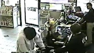 New Video Shows Armed Robber In Action