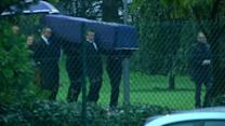 Bodies of journalists arrive in France