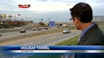 Gas prices briefly drop as holiday travel kicks off