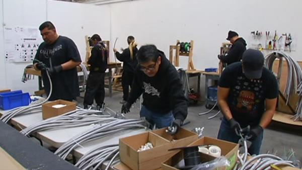 East Bay congressman visits, works at local factory