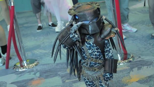 Little kid dresses up in a mini Predator costume