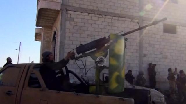 Rebels battle for northern Syria town