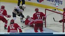 Cam Ward robs Gregory Campbell in front