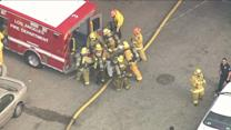 Raw: Injured Firefighter Wheeled From Burning Church