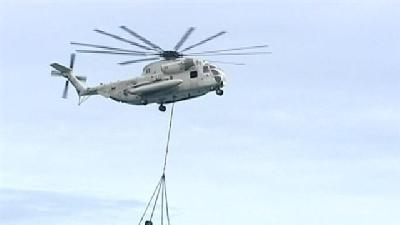 Wreckage Of Downed Helicopter Gets Cleaned Up